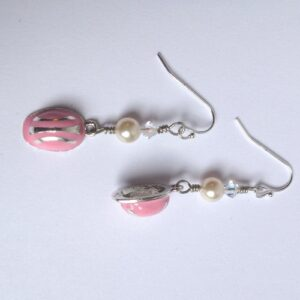 """Pink Hard Hat Earrings Pink is a positive color inspiring a comforting feeling, and a sense that everything will be okay. The Pink Hard Hat Earrings are finished in silver plated lead free pewter, with Sterling Silver Ear wires. The Earrings dangle 1-1/2"""" long with Swarovski Crystal and Swarovski Pearls. Beautifully packaged in a drawstring pouch with story card. Made in the USA"""